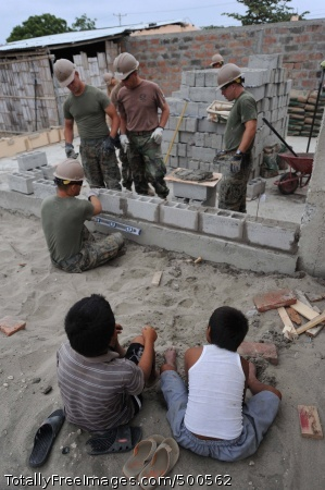 110517-F-ET173-200 LA TAVESIA, Ecuador (May 17, 2011) Ecuadorian boys watch as Seabees assigned to Naval Mobile Construction Battalion (NMCB) 28 and Marines assigned to the 8th Engineer Support Battalion build a wall at their school in La Tavesia, Ecuador during a Continuing Promise 2011 community service project. Continuing Promise is a five-month humanitarian assistance mission to the Caribbean, Central and South America. (U.S. Air Force photo by Staff Sgt. Alesia D. Goosic/Released)