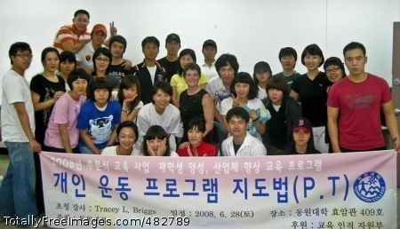 Bodybuilder Tracey Yongsan bodybuilding champ Tracey Briggs (center) stands with students from Tongwon College southeast of Seoul after presenting a lecture on fitness and bodybuilding. Briggs presented a four-hour class on fitness and bodybuilding to students who may someday become professional fitness trainers. Photo Credit: Aug 5, 2008