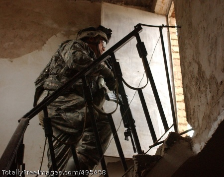 Operations in Iraq Pfc. Anthony Pardella, from the 501st Parachute Infantry Regiment, searches a house for weapons in Mussayyib, Iraq. Photo Credit: Jan 16, 2007