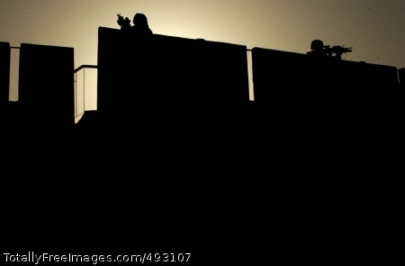 Soldier Silhouettes Soldiers pull security on a rooftop during a combined cordon and search mission with Iraqi police in the Rashid district of Baghdad, May 6. The Soldiers are from Company B, 1st Battalion, 23rd Infantry Regiment, 3rd Stryker Brigade Combat Team, 2nd Infantry Division. Photo Credit: Jun 7, 2007