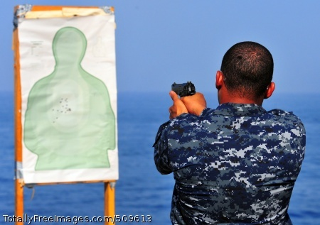 100917-N-7948R-102 ARABIAN SEA (Sept. 17, 2010) Navy Counselor 1st Class Khafre Quintall fires a 9mm handgun during small arms training aboard the amphibious dock landing ship USS Pearl Harbor (LSD 52). Pearl Harbor is part of Peleliu Amphibious Ready Group supporting maritime security operations and theater security cooperation efforts in the U.S. 5th Fleet area of responsibility. (U.S. Navy photo by Mass Communication Specialist 2nd Class Michael Russell/Released)