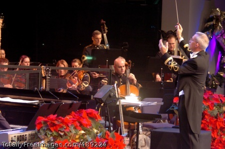 The downbeat Col. Thomas Rotondi Jr. gives the downbeat for the Army Orchestra and Chorus at Pershing's Own's annual holiday concert. The show from 2006 is out on DVD to the troops, but the final show this year broadcast live to military outlets overseas. Photo Credit: Dec 10, 2007