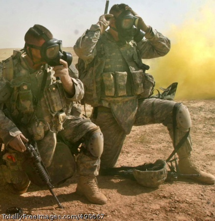 Defensive Training Soldiers don and clear their masks. Photo Credit: Oct 9, 2007