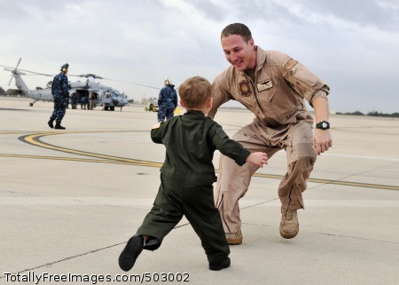 110319-N-BT887-003 SAN DIEGO (March 19, 2011) Naval Air Crewman 2nd Class Bret Pembleton, assigned to Helicopter Sea Combat Squadron (HSC) 12, greets his son after a six-month deployment aboard the aircraft carrier USS Abraham Lincoln (CVN 72). HSC-12 is part of the Abraham Lincoln Carrier Strike Group, which was deployed to the U.S. 5th and 7th Fleet areas of responsibility. (U.S. Navy photo by Mass Communication Specialist Seaman Benjamin Crossley/Released)