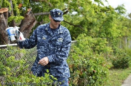 110622-N-WP746-063 JOINT BASE PEARL HARBOR-HICKAM, Hawaii (June 22, 2011) Lt. Cmdr. Michael Dube, assigned to Joint Base Pearl Harbor-Hickam, picks up rubbish along Kamehameha Highway, outside the Pearl Harbor Visitors Center. Joint Base Pearl Harbor-Hickam and all its tenant commands are taking part in a base-wide installation cleanup and maintenance of their respective areas. (U.S. Navy photo by Mass Communication Specialist 2nd Class Mark Logico/Released)