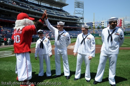 110515-N-AD372-286 WASHINGTON (May 15, 2011) Washington Nationals mascot Screech high fives Hospital Corpsman 1st Class Andrew Jenkins, U.S. Pacific Fleet Sailor of the Year, at the Nationals Park prior to a major league baseball game between the Nationals and the Florida Marlins. The four Sailors will be meritoriously promoted to chief petty officers for their accomplishments. (U.S. Navy photo by Mass Communication Specialist 1st Class Abraham Essenmacher/Released)