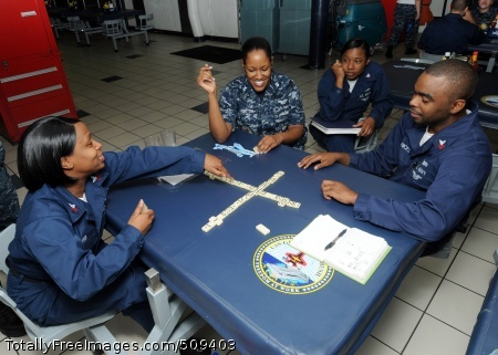 100926-N-6632S-130 ATLANTIC OCEAN (Sept. 26, 2010) Sailors assigned to the aircraft carrier USS George H.W. Bush (CVN 77) play a game of dominos in the ship's galley. George H.W. Bush is conducting training in the Atlantic Ocean. (U.S. Navy photo by Mass Communication Specialist Seaman Kevin J. Steinberg/Released)