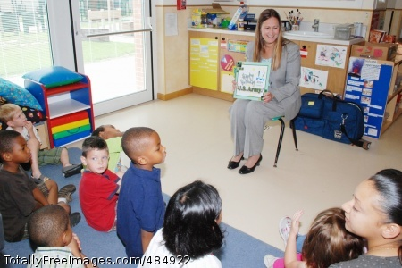 IMCOM-Europe Diane Devens, director of Installation Management Command-Europe, reads to children three to five-years-old while visiting the Child Development Center on Caserma Ederle, Italy, June 13. Various events held to celebrate the Army's 233rd Birthday included activities at the U.S. Army Garrison Vicenza Child and Youth Services.  Photo Credit: Jun 14, 2008