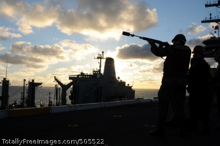 110107-N-9132C-163 PACIFIC OCEAN (Jan. 7, 2011) Gunner's Mate Seaman Chris Brenzai, from Warren, Ohio, uses an M-14 rifle to fire a shot line from the flight deck of the aircraft carrier USS Ronald Reagan (CVN 76) during a replenishment at sea with the Military Sealift Command fleet replenishment oiler USNS Guadalupe (T-AO 200). Ronald Reagan is underway preparing for an upcoming deployment. (U.S. Navy photo by Mass Communication Specialist 3rd Class Oliver Cole/Released)
