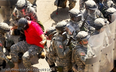Non-Lethal Force Soldiers face down a crowd of instructors role-playing as rioters  Photo Credit: Sep 7, 2007