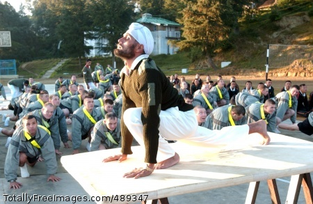 Ghurkha Trains Sgt. Gurdev Singh, a Indian Army master physical fitness instructor, leads Soldiers from C Company, 3/21st Infantry, in a Yoga exercise during morning fitness training as part of Exercise Yudh Abhyas.  Photo Credit: Dec 3, 2007