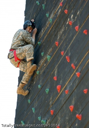 Climbing to the Top FORT BENNING, Ga. -- April 21, 2007 -- A competitor takes on the rock climbing wall during day two of the Army's Best Ranger Competition. Twenty one of the 41 teams qualified for day two after last night's 26-mile foot march.  Photo Credit: Apr 21, 2007