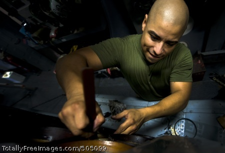110119-N-2055M-048  SOUTH CHINA SEA (Jan. 19, 2011) Aviation Ordnanceman 2nd Class Adrel Alcaraz-Medina performs maintenance on a sono launcher on an SH-60B Sea Hawk helicopter assigned to Helicopter Anti-Submarine Squadron (HSL) 49 aboard the Arleigh Burke-class guided-missile destroyer USS Gridley (DDG 101). Gridley is on deployment with the Carl Vinson Carrier Strike Group to the U.S. 7th Fleet area of responsibility. (U.S. Navy photo by Mass Communication Specialist 3rd Class Travis K. Mendoza/Released)