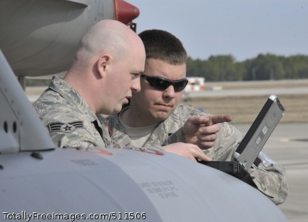 TYNDALL AIR FORCE BASE, Fla. - Maintainers from the 179th Fighter Squadron, a subordinate unit of the 148th Fighter Wing out of Duluth, Minn., review technical data prior to preparing an aircrew for a mission at Tyndall Air Force Base, Fla., Jan. 27. The 148th FW is working with the 53rd Weapons Evaluation Group at Tyndall AFB for two weeks to train for their Air Sovereignty Alert missions and to validate their new Block 50 F-16s.