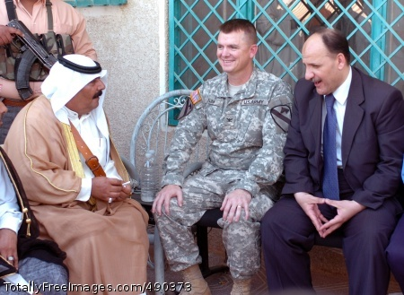 A local tribal leader (left), Col. Paul E. Funk II (center), commander, 1st Brigade Combat Team, 1st Cavalry Division and an Iraqi government representative converse on the accomplishments and goals for reconciliation at the grand opening of the Sheiks Conference Center near Taji, Iraq Oct. 18.   Photo Credit: Oct 24, 2007