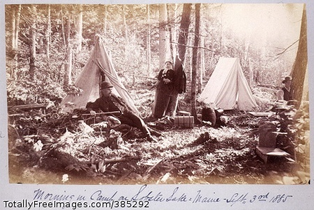 Morning in camp on Lobster Lake, Maine - Sept. 3rd 1885 Two men and a woman near tents in camp on Lobster Lake. 