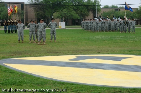 Col. Dan Shanahan, front left, stands in front of his staff during a change of command ceremony for the 1st Air Cavalry 'Warrior' Brigade, 1st Cavalry Division, April 4 on Cooper Field. In the ceremony, Shanahan relinquished command of the brigade to Col. Douglas M. Gabram. Photo Credit: Apr 8, 2008