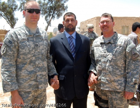 Baumholder (Left to right) Capt. Charles Cannon, commander of Battery A, 1st Battalion, 10th Field Artillery, Qussin Yassim, leader of the Tessah Nissan Sons of Iraq group, and Capt. Matthew Hustead of U.S. Army Europe's 4th Battalion, 27th Field Artillery, join hands in a symbolic gesture of the continued bond between the SoI and coalition forces after a farewell ceremony for the departing 1-10th at Tessah Nissan, Iraq, May 1. The recently arrived 4-27th will continue the mission the 1-10th performed during its deployment in support of Operation Iraqi Freedom Photo Credit: May 7, 2008