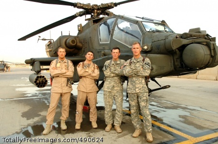 (Left to right) Chief Warrant Officer 3 Terry Eldridge, Capt. Thomas Loux, Chief Warrant Officer 2 Cole Moughon and Chief Warrant Officer 3 Kyle Kittleson pose in front of an AH-64D Apache. The four pilots from 1st 'Attack' Battalion, 227th Aviation Regiment, 1st Air Cavalry Brigade, 1st Cavalry Division, reacted quickly when they came upon four anti-aircraft gun trucks and 20 heavily armed insurgents on Sept. 29.  Photo Credit: Oct 10, 2007