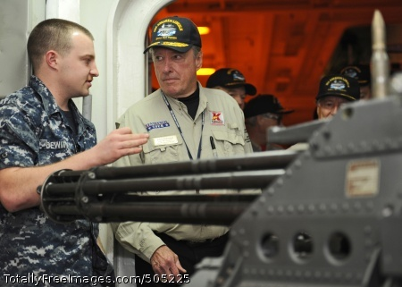 110115-N-8824M-146 ARABIAN SEA (Jan. 15, 2011) Three-time Indianapolis 500 winner Johnny Rutherford is given a description of the M61 A1 Vulcan machine gun by Aviation Ordnanceman Airman Nicholas Dewitt aboard the aircraft carrier USS Abraham Lincoln (CVN 72). Rutherford visited the deployed ship as part of the centennial celebration of the famous race and to boost the crew's morale. The Abraham Lincoln Carrier Strike Group is deployed in the U.S. 5th Fleet area of responsibility in support of maritime security operations and theater cooperation efforts. (U.S. Navy photo by Mass Communication Specialist 3rd Class Spencer Mickler/Released)