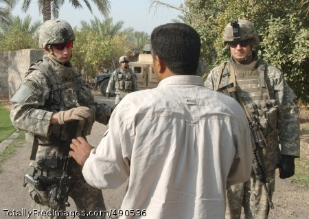 Sgt. Ken Thomas (left), a team leader for Troop C, 1st Squadron, 7th Cavalry Regiment and a native of Utopia, Texas, Sgt. 1st Class Michael Fernandez (second from left), a platoon sergeant for Troop C who hails from Killeen, Texas and Pfc. Zach Foege, a Troop C scout from Watertown, Wis., meet a local Iraqi man who welcomed them over to chat during a foot patrol near Taji, Iraq Oct. 6. Thomas received the Silver Star Medal for actions taken during a joint operation with the Iraqi Police in Falahat, Iraq Feb. 16.  Photo Credit: Oct 15, 2007