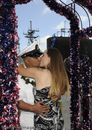110531-N-UK333-167 JOINT BASE PEARL HARBOR-HICKAM, Hawaii (May 31, 2011) Chief Electronics Technician Daniel Villarreal is greeted by his wife as he is the first to disembark the Los Angeles-class attack submarine USS Charlotte (SSN 766) after a six-month deployment to the western Pacific region. Charlotte departed Pearl Harbor Dec. 1, 2010. (U.S. Navy photo by Mass Communication Specialist 2nd Class Ronald Gutridge/Released)