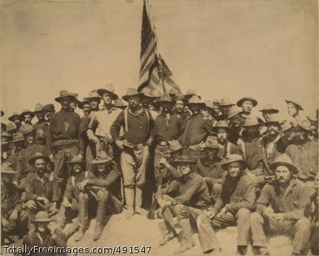 Hispanic Americans Roosevelt's 'Rough Riders' pose for a group photo while proudly displaying the American flag. Photo Credit: Sep 13, 2007
