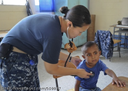 100908-N-9964S-102 PUERTO BARRIOS, Guatemala (Sept. 8, 2010) Lt. Amanda Higginson, assigned to the multi-purpose amphibious assault ship USS Iwo Jima (LHD 7), checks a child's heartbeat during clinic hours at the pediatric center in Guatemala. Iwo Jima is off the coast of Guatemala supporting Continuing Promise 2010, a humanitarian and civic assistance mission. The assigned medical and engineering staff embarked aboard Iwo Jima are working with partner nation's teams to provide medical, dental, veterinary, engineering assistance to eight nations. (U.S. Navy photo by Mass Communication Specialist 1st Class Christopher B. Stoltz/Released)
