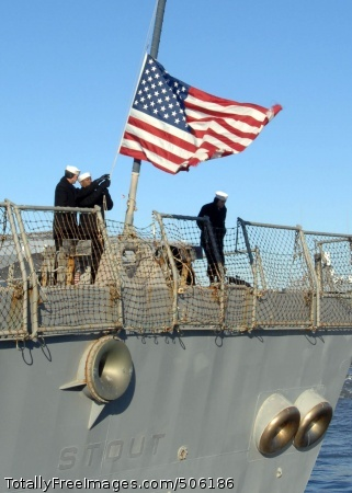 101215-N-5292M-108 NORFOLK (Dec. 15, 2010) Sailors aboard the guided-missile destroyer USS Stout (DDG 55) remove the national ensign as the ship pulls away from the pier at Naval Station Norfolk. Stout is deploying to the Mediterranean Sea and the U.S. 6th Fleet area of responsibility, where it will be conducting its second Ballistic Missile Defense (BMD) system deployment. BMD will be the primary mission for the ship during this six-month deployment. (U.S. Navy photo by Mass Communication Specialist 1st Class Julie R. Matyascik/Released)