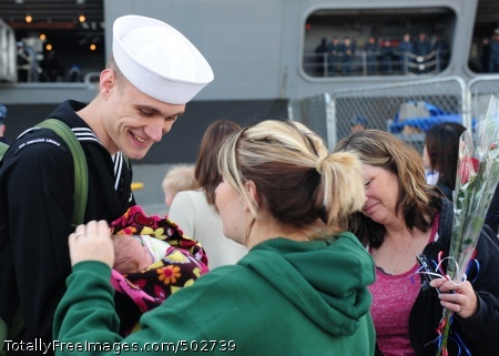 110324-N-YL945-015  EVERETT, Wash. (March 24, 2010) A Sailor greets his wife and newborn baby moments after arriving aboard the aircraft carrier USS Abraham Lincoln (CVN 72). Abraham Lincoln returned home from a six-month deployment in the U.S. 5th and 7th Fleet areas of responsibility supporting maritime security operations and theater security cooperation efforts. (U.S. Navy photo by Mass Communication Specialist 3rd Class Colby K. Neal/Released)