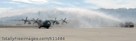 PETERSON AIR FORCE BASE, Colo. – Air Force Gen. Gene Renuart, North American Aerospace Defense Command and U.S. Northern Command, taxis a 302nd Airlift Wing C-130 beneath arcs of water fired from Peterson AFB Fire Department fire trucks at the end of his final flight May 5.
