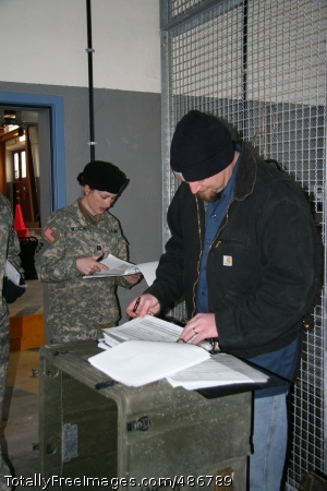 405th AFSB helps Capt. Penny Bloedel, commander of the 54th Engineer Battalion Field Support Company, double checks inventory numbers with Honeywell contractor Mike Hansen as she and her unit prepare to put their equipment into the LBE program prior to deployment.