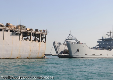 101223-N-8069G-032 ARABIAN GULF (Dec. 23, 2010) U.S. Army logistics support vessel USAV SP/4 James A. Loux (LSV 6) separates from the amphibious dock landing ship USS Carter Hall (LSD 50) after performing a stern gate transfer. Carter Hall is part of the Kearsarge Amphibious Ready Group supporting maritime security operations and theater security cooperation efforts in the U.S. 5th Fleet area of responsibility. (U.S. Navy photo by Mass Communication Specialist 3rd Class Kristin L. Grover/Released)