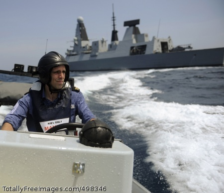 110628-N-MY642-402 ATLANTIC OCEAN (June 28, 2011) A sailor assigned to the Royal Navy destroyer HMS Dauntless (D 33) pilots a rigid-hull inflatable boat for the transport of a British visit, board, search and seizure team during an exercise supporting FRUKUS 2011. FRUKUS is an invitational exercise designed to enhance communication and interoperability between the navies of France, Russia, the United Kingdom and the United States. (U.S. Navy photo by Mass Communication Specialist Seaman Donald R. White Jr./Released)