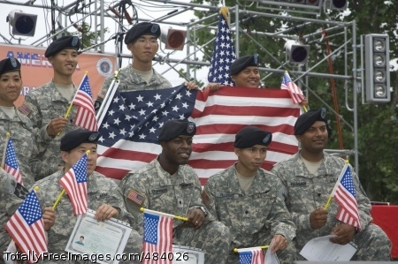 Naturalization The newest U.S. citizens pose with U.S. flags after the USAG-Yongsan July 4 Naturalization Ceremony. Photo Credit: Jul 4, 2008