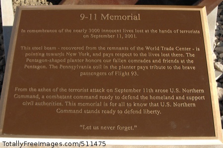 PETERSON AIR FORCE BASE, Colo. - The plaque of the new 9-11 memorial describes the design of the memorial and its three parts, the steel beam representing the World Trade Center, the five-sided planter representing the Pentagon, and Pennsylvania soil representing crash site of Flight 93. The memorial will be commemorated in a ceremony at 1 p.m. May 18.