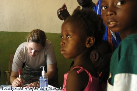 New Commander Army Capt. Laura Porter prescribes medication for children during a medical capabilities exercise Sept. 3, in Senkoro, Mali. Photo Credit: Oct 5, 2007