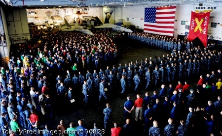 101202-N-5361G-006 MEDITERRANEAN SEA (Dec. 2, 2010) Sailors and Marines gather in the hangar bay aboard the aircraft carrier USS Harry S. Truman (CVN 75) for a promotion ceremony for 220 Sailors. The Harry S. Truman Carrier Strike Group is deployed supporting maritime security operations and theater security cooperation efforts in the U.S. 5th and 6th Fleet areas of responsibility. (U.S. Navy photo by Mass Communication Specialist 3rd Class David Giorda/Released)