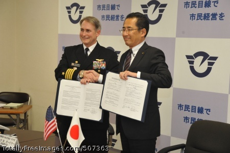 101117-N-8730P-146   FUJISAWA, Japan (Nov. 17, 2010) Capt. Eric Gardner, left, commanding officer of Naval Air Facility Atsugi, and Fujisawa City Mayor Yasunori Ebine shake hands after signing a memorandum of understanding at Fujisawa City Hall. The memorandum outlines what Naval Air Facility Atsugi can do for Fujisawa City during and after major crises such as a typhoon or earthquake. The three-year goal for the naval air facility is to have a signed memorandum of understanding with all of the cities surrounding the installation. (U.S. Navy photo by Mass Communication Specialist 1st Class Charles Panter/Released)