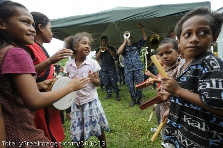 110420-N-YM863-421 TALI HAU, Tonga (April 20, 2011) Children dance and play percussion instruments while the Pacific Partnership 2011 band performs during a ribbon cutting ceremony. Pacific Partnership is a five-month humanitarian assistance initiative that will make port visits to Tonga, Vanuatu, Papua New Guinea, Timor-Leste, and the Federated States of Micronesia. (U.S. Navy photo by Mass Communication Specialist 1st Class Eli J. Medellin/Released)