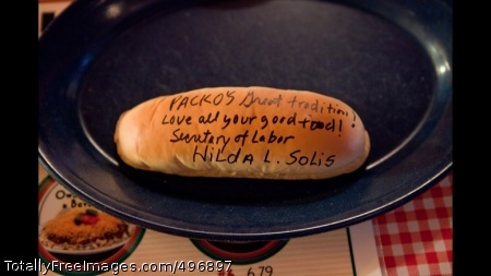 A Message From Secretary Of Labor Hilda Solis A message from Secretary of Labor Hilda Solis adorns a hot dog bun at Tony Packo\'s restaurant in Toledo, Ohio, Feb. 8, 2011. Hot dog buns signed by celebrities and politicians line the walls at Packo\'s, a tradition that started when actor Burt Reynolds visited the restaurant in 1972. (Official White House Photo by Samantha Appleton)