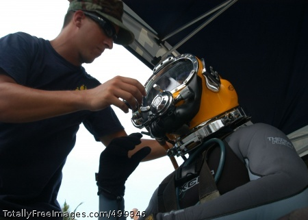 110612-N-OS584-058 KUANTAN, Malaysia  (June 12, 2011) Navy Diver 2nd Class Jason Pelle prepares Navy Diver 3rd Class Brett McEntire for a salvage dive during Cooperation Afloat Readiness and Training (CARAT) Malaysia 2011. CARAT is a series of bilateral exercises held annually in Southeast Asia to strengthen relationships and enhance force readiness. (U.S. Navy photo by Mass Communication Specialist 2nd Class Jimmie Crockett/Released)