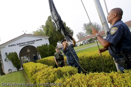 100917-N-8863V-097 NORCO, Calif. (Sept. 17, 2010) Deptartment of Defense Police Officer Joey Miles, right, and U.S. Navy Master-at-Arms 3rd Class Anthony Roman, middle, raise the POW/MIA flag on POW/MIA day as Master-at-Arms 1st Class Renee Davidson observes at Naval Surface Warfare Center, Corona Division. (U.S. Navy photo by Greg Vojtko/Released)
