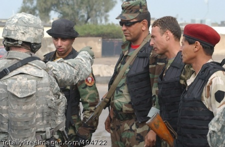 Walking the Beat Staff Sgt. John Andrews gives directions to Iraqi National Police officers on clearing a route for a coalition convoy that will be moving through the area shortly. Photo Credit: Feb 28, 2007