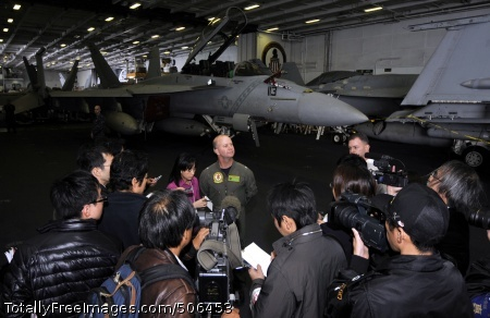 101209-N-7103C-161 PACIFIC OCEAN (Dec. 9, 2010) Capt. Ross Myers, commander of Carrier Air Wing (CVW) 5, speaks with embarked Japanese reporters in the hangar bay aboard the aircraft carrier USS George Washington (CVN 73). George Washington is participating in Keen Sword 2011 with the Japan Maritime Self-Defense Force. This exercise enhances the Japan/U.S. alliance, which remains a key strategic relationship in the Northeast Asia Pacific region. (U.S. Navy photo by Mass Communication Specialist 3rd Class David A. Cox/Released)
