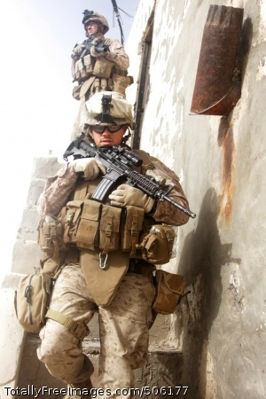 101206-M-5112P-086 SANGIN, Afghanistan (Dec. 6, 2010) Hospital Corpsman 2nd Class Jeffery R. Bowman, assigned to Police Advisor Team 1, Headquarters and Service Company, 3rd Battalion, 5th Marines Regiment, goes down the stairs of a Afghan uniformed police checkpoint during a security patrol through the Bazaar in Sangin District, Afghanistan. The battalion is one of the combat elements of Regimental Combat Team 2, conducting counterinsurgency operations in partnership with the International Security Assistance Force. (U.S. Marine Corps photo by Lance Cpl. Joseph M. Peterson/Released)
