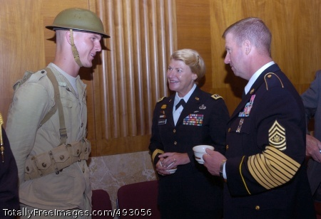 U.S. Senate 232nd Maj. Gen. Ann E. Dunwoody joins Sgt. Maj. of the Army Kenneth O. Preston in a discussion with an Old Guard Soldier about his Army uniform from the past during the U.S. Senate 232nd Army Birthday Ceremony in Washington, D.C., June 12.  Photo Credit: Jun 12, 2007