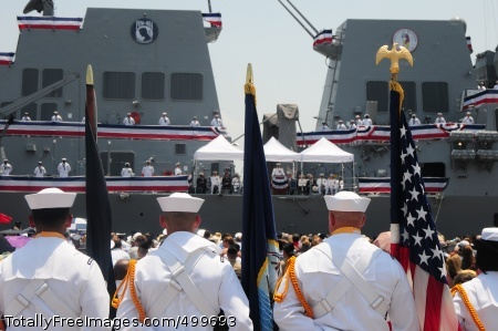 110604-N-WI828-003 MOBILE, Ala. (June 4, 2011) Members of a U.S. Navy color guard look on as the crew of the Arleigh Burke-class guided-missile destroyer USS William P. Lawrence (DDG 110) man the rails and bring the ship to life during the ship's commissioning ceremony. The new destroyer honors the late Vice Adm. William P. Lawrence, a naval aviator who served as a test pilot and endured 6 years as a prisoner of war in Vietnam.  Lawrence went on to serve as the superintendent of the U.S. Naval Academy and Chief of Naval Personnel. (U.S. Navy photo by Lt. Cmdr. Mark C. Jones/Released)